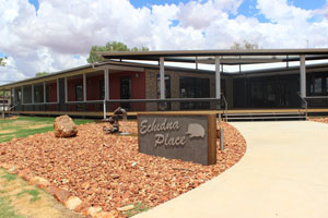 Building frontage with signage in front reading Echidna Place